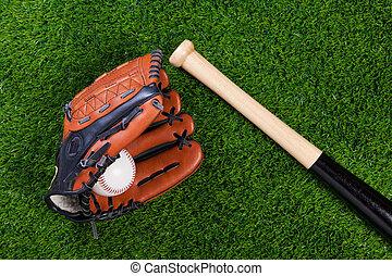 Baseball glove bat and ball on grass - Photo of a Baseball...