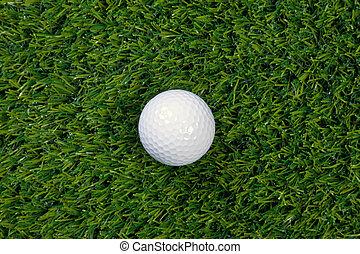 Golf ball on grass - A photo of a golf ball on grass