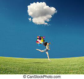 Jumping with balloons - Girl jumps with colored balloons in...