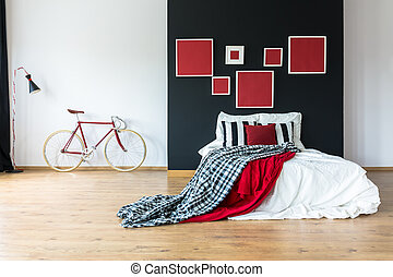 Red coverlet on king-size bed - Red and patterned coverlet...