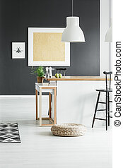 Rustic dining room with pouf