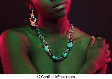 Colorful and creative portrait of african womans upper body...