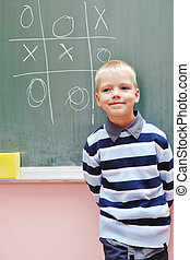 happy young boy at first grade math classes