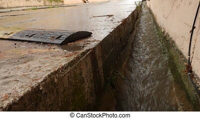 storm sewerage during the rain. Environmental problems. 4k,...