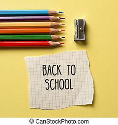 pencil crayons, sharpener and text back to school