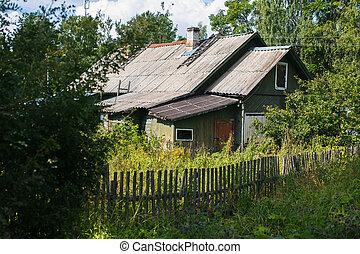 Abandoned wooden house in settlement in Leningrad region,...