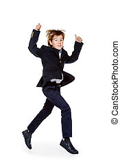 rush to school - Happy excited boy in school uniform jumping...