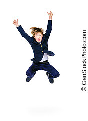 back to school - Happy excited boy in school uniform jumping...