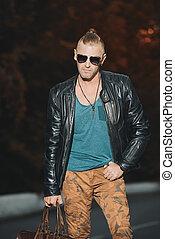 brutal male style - Handsome brutal man in leather jacket...