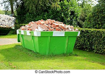 Loaded garbage dumpster - Loaded dumpster near a...