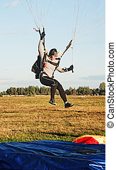 The landing girl parachutist