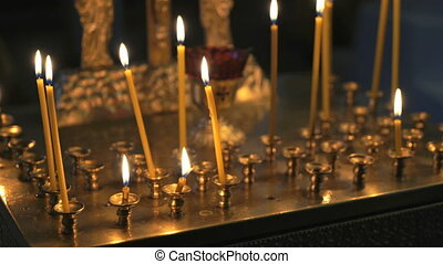 Burning Church candles in the temple. Close up - Religious...