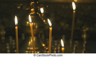 Candlestick with burning candles in the temple - Religious...