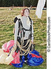 The girl-parachutist after a landing - The girl-parachutist...