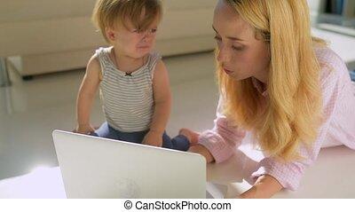 Sad little girl sitting on the floor - Do not cry, my dear....