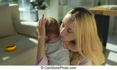 Kind mother soothing the child - No reasons for crying. Kind...