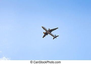Airplane in the blue sky - Picture of an airplane flying...