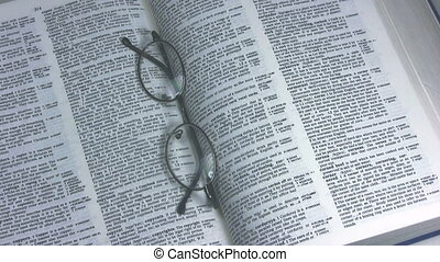 Copyright writing and glasses - Hand writing the word...