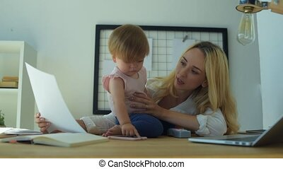 Young mother preparing for business conference - Working...