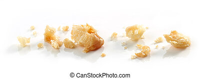 Cheese cookie crumbs macro isolated on white background