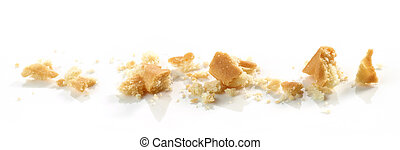 Cookie crumbs macro isolated on white background