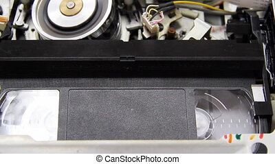 videotape into the VCR
