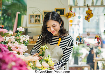 Portrait of young business woman florist working at flower shop