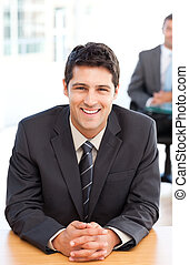Happy businessman during an interview with a colleague at...