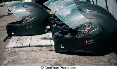 Car helmets lying on the table before the competition