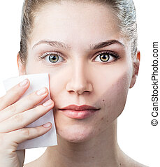 Young woman cleaning her face by napkins. Skincare concept....