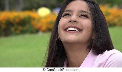 Happy Teen Girl Wondering Or Daydreaming