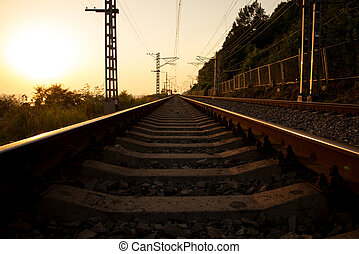 The railroad and wires at sunset - Horizontal shot of the...
