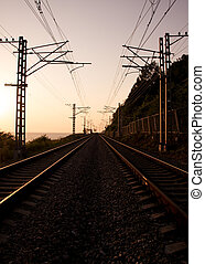 The railroad and wires at sunset - Vertical shot of the...