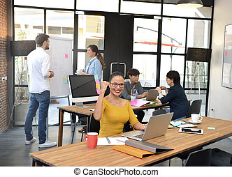Senior businesswoman smiling at camera in office environment