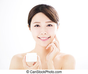 beautiful young woman showing beauty product on hand