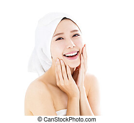 Young woman with towel on head in spa salon