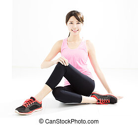 young woman doing fitness stretchingyoga