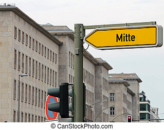 Arrow with text MITTE the most central district of East...