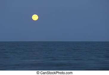 big full moon and the ocean - big full moon over the ocean...