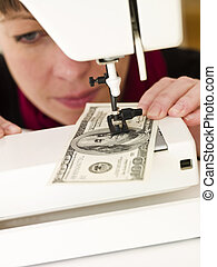 Woman sewing money - Woman holding with Hundred dollar bank...