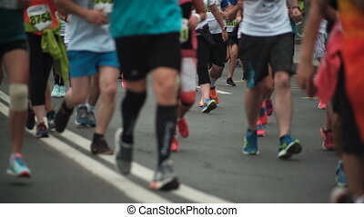 Close-up view of the people s feet in sportswear and...