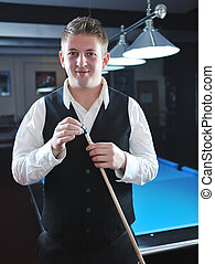 young man play pro billiard game - young pro billiard player...