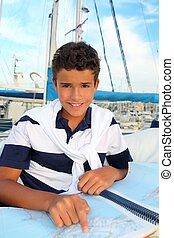 boy teen sailorsitting on marina boat chart map - boy teen...