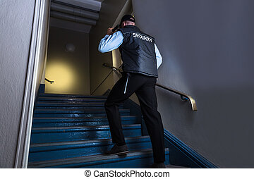 Close-up Of Male Security Officer - Rear View Of A Male...