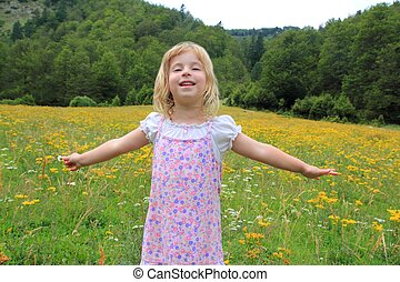 Open arms girl in beautiful flower spring meadow