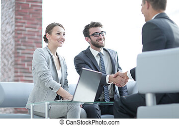 handshake business partners after discussing the contract