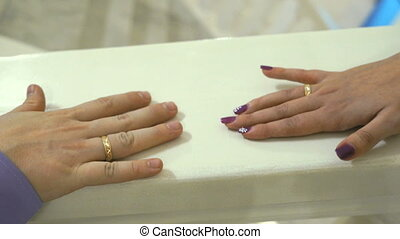 Hands's newlyweds are bonded together. Close up - Hands's...