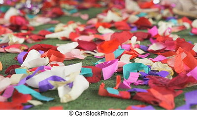 Red, white rose petals scattered on a green carpet - Wedding...