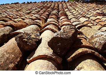 clay roof tiles old aged arabic style in Spain