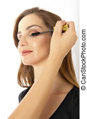 Eye makeup - Pretty woman getting eye makeup